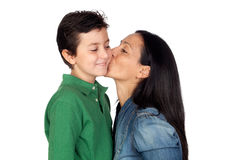 Adorable mother kissing her beautiful son. Isolated on white background Stock Images