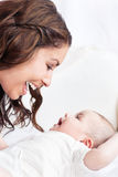 Adorable mother playing with her baby Stock Photography