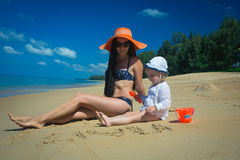Adorable mother with pretty little girl on vacation Stock Images