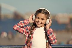 Adorable music lover. Little kid enjoy listening to music. Little girl wearing stereo headphones. Little child with. Wireless headset. Little child using stock image