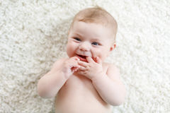 Adorable naked baby girl on white background. Royalty Free Stock Photos
