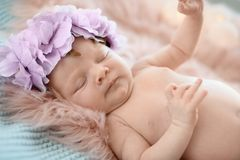 Adorable newborn baby girl with floral headband stock photo