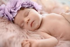 Adorable newborn baby girl with floral headband sleeping royalty free stock photos