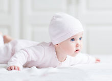 Adorable newborn baby girl in a pink knited hat Royalty Free Stock Photo