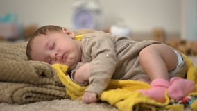 Adorable newborn baby girl sleeping peacefully, natural clothing and bedding