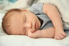 Adorable newborn baby peacefully sleeping stock photo