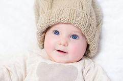 Adorable newborn baby wearing big knitted hat. Adorable newborn baby wearing a big knitted hat and a wam sweater Royalty Free Stock Photography