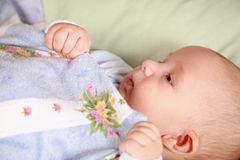 Adorable newborn in bed Stock Photos