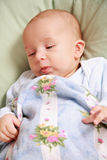 Adorable newborn in bed Stock Photo