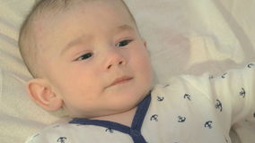 Adorable newborn boy playing with his mother stock video