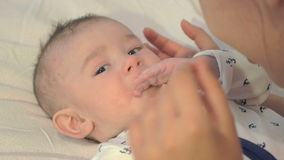 Adorable newborn boy playing with his mother stock footage