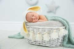 Adorable newborn child wearing bunny ears hat in baby nest stock photos