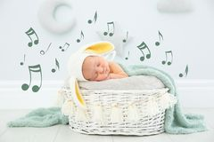 Adorable newborn child wearing bunny ears hat in baby nest royalty free illustration