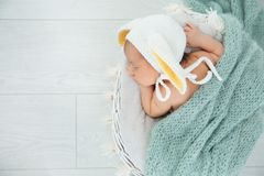 Adorable newborn child wearing bunny ears hat in baby nest, top view stock photography