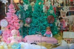 Adorable, nostalgic image of Christmas joy in storefront window,G Willikers,Saratoga,New York,2015 Stock Image