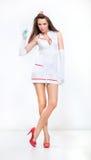 Adorable nurse in high heels Stock Photography