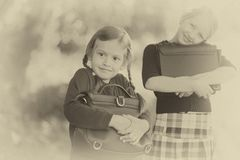 Two little girls ready back to school closeup, autumn day. stock photo