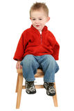 Adorable One Year Old Boy Sitting On Step Stool stock photo