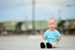 Adorable one year old boy train tracks Stock Photos