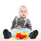 Adorable one year old child boy playing with a toy Royalty Free Stock Images
