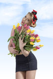 Adorable pin-up with colourful bouquet Stock Photography