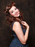Adorable Pin Up Style Girl in Studio Stock Photography
