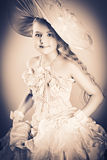 Adorable. Portrait of a charming little lady in a beautiful elegant dress Royalty Free Stock Images