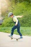 Adorable preschool child, skateboarding on the street Stock Photography