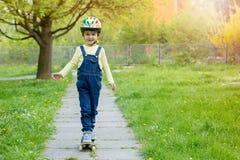Adorable preschool child, skateboarding on the street Royalty Free Stock Photo