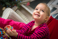 Adorable preschool girl playing with sweets Stock Photos