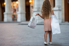 Adorable preschool girl walking with shopping bags in Paris outdoors Royalty Free Stock Photography