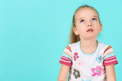 Adorable preschooler girl deep in thoughts, looking up. Concentration, decision, vision concept. Adorable preschooler girl deep in thoughts, looking up Royalty Free Stock Image