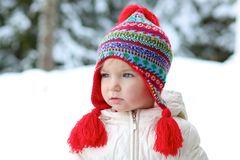 Adorable preschooler girl enjoys winter at ski resort Stock Photography