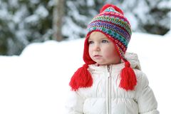 Adorable preschooler girl enjoys winter at ski resort Royalty Free Stock Image