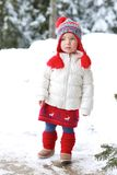 Adorable preschooler girl enjoys winter at ski resort Stock Image