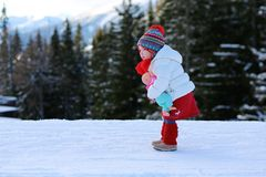 Adorable preschooler girl enjoys winter at ski resort Royalty Free Stock Images