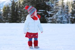 Adorable preschooler girl enjoys winter at ski resort Stock Photos