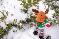 Adorable preschooler in winter wear sit amoung snow and play wit Stock Image