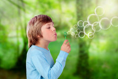 Adorable preteen boy blowing for make bubbles Stock Image