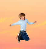 Adorable preteen boy jumping Stock Image