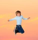 Adorable preteen boy jumping Stock Image