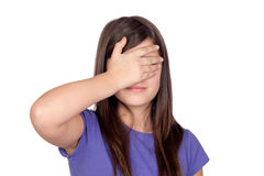 Adorable preteen covering her eyes Stock Photography