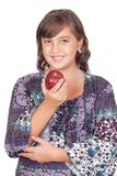 Adorable preteen girl with a apple Stock Image
