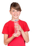 Adorable preteen girl with bottled water. Isolated on white background Royalty Free Stock Images