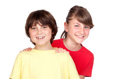 Adorable preteen girl and little boy. Isolated on white background Royalty Free Stock Photography