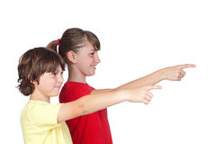 Adorable preteen girl and little boy. Finger pointing isolated on white background Stock Photo