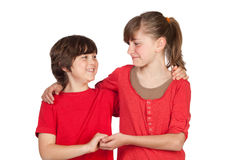 Adorable preteen girl and little gir in red. Isolated on white background Royalty Free Stock Images