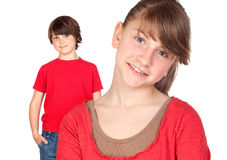 Adorable preteen girl and little gir in red. Isolated on white background Royalty Free Stock Photos
