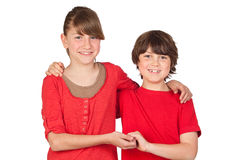 Adorable preteen girl and little gir in red Stock Photos