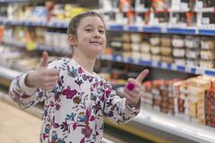 Adorable preteen girl in the market.  Royalty Free Stock Photography
